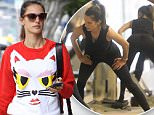 Alessandra Ambrosio wears a cute cat sweatshirt heading into yoga. The Victoria's Secret Angel makes a few checks to her phone before beginning the group class in which she breaks a sweat. Saturday, April 9, 2016 X17online.com