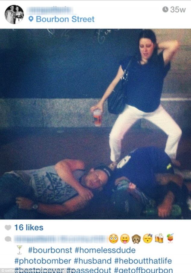 Tasteless: This young woman posted this picture of herself gesturing lewdly over passed out homeless men