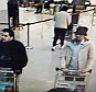 """Belgian bomber Ibrahim El Bakraoui, centre, and a mystery fourth bomber, left, both wearing black gloves to hide their suicide bomb triggers, killed 14 at Brussels airport - their accomplice the 'Man in White' Laachraoui, right, walked out of the airport. This CCTV image from the Brussels Airport surveillance cameras made available by Belgian Police, shows what officials believe may be suspects in the Brussels airport attack on March 22, 2016. The Belgian state prosecutor said in a press conference on Tuesday, that a photograph of three male suspects was taken at Zaventem. """"Two of them seem to have committed suicide attacks. The third, wearing a light-coloured jacket and a hat, is actively being sought,"""" the prosecutor said. REUTERS/CCTV/Handout via Reuters ATTENTION EDITORS - THIS PICTURE WAS PROVIDED BY A THIRD PARTY. REUTERS IS UNABLE TO INDEPENDENTLY VERIFY THE AUTHENTICITY, CONTENT, LOCATION OR DATE OF THIS IMAGE. EDITORIAL USE ONLY. NOT FOR SALE FOR MARKETING OR ADVERTISING CAMP"""
