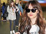 """*EXCLUSIVE* Vancouver, BC - Dakota Johnson arrives at Vancouver International Airport with a friend and bodyguard to head home for the weekend. The 26-year-old actress has been hard at work shooting for """"Fifty Shades Darker"""" and """"Fifty Shades Freed."""" Dakota is off to enjoy a well deserved break from set. She keeps it casual in jeans and a tee paired with Converse. \n  \nAKM-GSI      April 9, 2016\nTo License These Photos, Please Contact :\nSteve Ginsburg\n(310) 505-8447\n(323) 423-9397\nsteve@akmgsi.com\nsales@akmgsi.com\nor\nMaria Buda\n(917) 242-1505\nmbuda@akmgsi.com\nginsburgspalyinc@gmail.com"""
