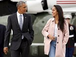 U.S. President Barack Obama and his daughter Malia walk from Marine One to board Air Force One upon their departure from O'Hare Airport in Chicago April 7, 2016.    REUTERS/Kevin Lamarque