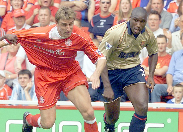 Escape! Boksic tries to wriggle free of Sol Campbell against Arsenal at the Riverside Stadium
