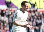 SWANSEA, UNITED KINGDOM - APRIL 09:  Gylfi Sigurdsson of Swansea City celebrates scoring his team's first goal during the Barclays Premier League match between Swansea City and Chelsea at the Liberty Stadium on April 9, 2016 in Swansea, Wales.  (Photo by Alex Morton/Getty Images)