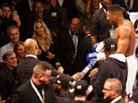 Jose Mourinho watches Anthony joshua celebrating after defeating Charles Martin during the IBF World Heavyweight title at the O2 Arena, London on April 9th 2016