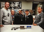 In this April 8, 2016 photo provided by the Port Authority of New York and New Jersey, Port Authority Police Officers display a .40 calibre handgun and .45 calibre ammunition confiscated from a 13-year-old boy at the Port Authority Bus Station in New York as he got off a bus from Virginia. From left are Port Authority Police Officer Steve Famiglietti; PA PO Dennis Novello; PA PO Len Guzman; PA Sgt. Hector Martinz and PA Lieutenant Jason Bailey. (Port Authority of New York and New Jersey Police Department via AP)