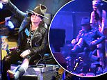 Axl Rose still performs with Guns N Roses in Las Vegas despite breaking his foot! Axl hobbled around on and off stage as he reunited with his band and Slash for their first concert together in 23 years! Axl arrived on a throne after breaking his foot earlier in the week but continued with his show. Axl thanked good friend Dave Grohl from the Foo Fighters who invented a throne to perform gigs on after breaking his foot! Axl used the throne to perform to 20,000 fans at the T-Mobile arean in Las Vegas\n\nPictured: Guns N Roses\nRef: SPL1259036  090416  \nPicture by: Splash News\n\nSplash News and Pictures\nLos Angeles: 310-821-2666\nNew York: 212-619-2666\nLondon: 870-934-2666\nphotodesk@splashnews.com\n