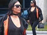 *EXCLUSIVE* Calabasas, CA - Kim Kardashian braves the rain to take husband Kanye West to his office. The curvaceous Kim keeps it simple in an all black outfit highlighted by a black satin jacket that was lined with bright orange, and a pair of hubby's Yeezy Boost 350 sneakers. \n  \nAKM-GSI        April 9, 2016\nTo License These Photos, Please Contact :\nSteve Ginsburg\n(310) 505-8447\n(323) 423-9397\nsteve@akmgsi.com\nsales@akmgsi.com\nor\nMaria Buda\n(917) 242-1505\nmbuda@akmgsi.com\nginsburgspalyinc@gmail.com