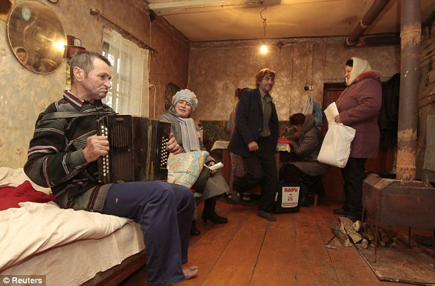 Electoral officials visit villagers during the parliamentary election, in the western Russian village of Gryaz, some (290 miles from Moscow yesterday