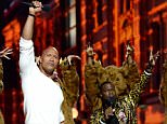 BURBANK, CALIFORNIA - APRIL 09:  Hosts Dwayne Johnson (L) and Kevin Hart perfrom onstage during the 2016 MTV Movie Awards at Warner Bros. Studios on April 9, 2016 in Burbank, California.  MTV Movie Awards airs April 10, 2016 at 8pm ET/PT.  (Photo by Kevin Mazur/WireImage for MTV)