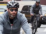 EXCLUSIVE: Hugh Jackman seen riding his bicycle on a rainy day in New York City on April 7, 2016.\n\nPictured: Hugh Jackman\nRef: SPL1239734  070416   EXCLUSIVE\nPicture by: GSNY /Splash News\n\nSplash News and Pictures\nLos Angeles: 310-821-2666\nNew York: 212-619-2666\nLondon: 870-934-2666\nphotodesk@splashnews.com\n