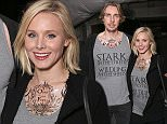 """HOLLYWOOD, CALIFORNIA - APRIL 10:  Dax Shepard and Kristen Bell wear Game of Thrones Shirts at Tattoos on a date night at the premiere of HBO's """"Game Of Thrones"""" Season 6 at TCL Chinese Theatre on April 10, 2016 in Hollywood, California.  (Photo by Todd Williamson/Getty Images)"""