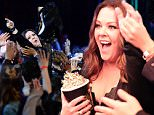 BURBANK, CALIFORNIA - APRIL 09:  Actress Melissa McCarthy crowd surfs her way to accept the Comedic Genius Award during the 2016 MTV Movie Awards at Warner Bros. Studios on April 9, 2016 in Burbank, California.  MTV Movie Awards airs April 10, 2016 at 8pm ET/PT.  (Photo by Kevin Mazur/WireImage for MTV)