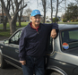 In an April 6, 2016 photo, Gettysburg, Pa. resident Mike Lawn stands next to a car formerly owned by Hillary Clinton in Gettysburg, Pa. The retired White House gardener is selling Clinton¿s 1986 Oldsmobile Cutlass, which he bought at an auction for the residence¿s workers and has been sitting in his Pennsylvania garage for years.  (Clare Becker/The (Hanover, Pa.) Evening Sun via AP)