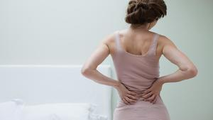 Can back pain cause nausea?