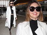 Los Angeles, CA - Miranda Kerr wows in white while departing LAX. The 32 year old model stuns in a white trench coat, black turtleneck crop top, black leggings, and black strappy heels. \nAKM-GSI     April 11, 2016\nTo License These Photos, Please Contact :\nSteve Ginsburg\n(310) 505-8447\n(323) 423-9397\nsteve@akmgsi.com\nsales@akmgsi.com\nor\nMaria Buda\n(917) 242-1505\nmbuda@akmgsi.com\nginsburgspalyinc@gmail.com