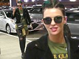 EXCLUSIVE: Ruby Rose is seen with GREEN cornrows, steel-heeled boots, torn jeans and a green graphic-tee.  The sexy model/actress (Orange is the New Black) was seen flying out of LAX.\n\nPictured: Ruby Rose\nRef: SPL1262001  110416   EXCLUSIVE\nPicture by: Sharky/Polite Paparazzi/Splash\n\nSplash News and Pictures\nLos Angeles: 310-821-2666\nNew York: 212-619-2666\nLondon: 870-934-2666\nphotodesk@splashnews.com\n