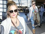 Los Angeles, CA - Kate Hudson rocks a boho casual look as she departs out of LAX. She's seen in fringe boots and her hair thrown up in a bun while carrying a heavy jacket. \n  \nAKM-GSI      April 12, 2016\nTo License These Photos, Please Contact :\nSteve Ginsburg\n(310) 505-8447\n(323) 423-9397\nsteve@akmgsi.com\nsales@akmgsi.com\nor\nMaria Buda\n(917) 242-1505\nmbuda@akmgsi.com\nginsburgspalyinc@gmail.com