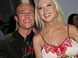 Tara Reid and Dean May with mohawk at the Meghan runway show on the final day of Mercedes-Benz Fashion Week in L.A. at Smashbox studio in the Culver City area of Los Angeles, CA   by Charley Gallay/LEP/Splash  Ref:  LECG 230306 D  Splash News and Pictures Los Angeles: 310-821-2666 New York: 212-619-2666 London: 207-107-2666 photodesk@splashnews.com