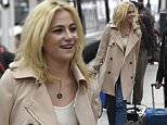 pixie lott mobbed by fans as she arrives at piccadilly train station in manchester