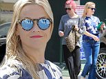 Santa Monica, CA - Reese Witherspoon rocks a blue ensemble for a skin care clinic visit in Santa Monica. Reese smiled for the cameras in flared blue jeans, strappy heels, a blue floral print top and blue mirrored shades as she returned to her car.\n \nAKM-GSI  April  12, 2016\nTo License These Photos, Please Contact :\nSteve Ginsburg\n(310) 505-8447\n(323) 4239397\nsteve@ginsburgspalyinc.com\nsales@ginsburgspalyinc.com\nor\nMaria Buda\n(917) 242-1505\nmbuda@akmgsi.com\nginsburgspalyinc@gmail.com