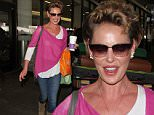Los Angeles, CA - Katherine Heigl arrives at LAX looking bright and happy but tries and cover her face from cameras. She quickly gives up and just flashes her big smile instead. \nAKM-GSI     April 12, 2016\nTo License These Photos, Please Contact :\nSteve Ginsburg\n(310) 505-8447\n(323) 423-9397\nsteve@akmgsi.com\nsales@akmgsi.com\nor\nMaria Buda\n(917) 242-1505\nmbuda@akmgsi.com\nginsburgspalyinc@gmail.com