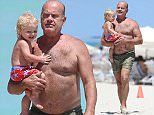 Actor and comedian Kelsey Grammer enjoying the ocean with daughter Faith Evangeline in Miami Beach  Pictured: kelsey grammer, faith evangeline Ref: SPL1260957  120416   Picture by: Splash News  Splash News and Pictures Los Angeles: 310-821-2666 New York: 212-619-2666 London: 870-934-2666 photodesk@splashnews.com