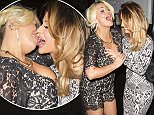 Picture Shows: Kerry Katona, Rosanna Jasmin  April 12, 2016    A busty Kerry Katona and a friend visited Secrets strip club in Kings Cross. On the way in Kerry had a bit of fun by French kissing her friend Rosanna Jasmin. Later on, Kerry's friend grabbed her boob and kissed Kerry on the cheek.     On the way out Kerry checked her bosom then playfully hugged everyone goodbye before heading home.    PHOTOS: Si Gross/Justin Palmer (NO BYLINE)    Non Exclusive  Worldwide Rights  Pictures by : FameFlynet UK © 2016  Tel : +44 (0)20 3551 5049  Email : info@fameflynet.uk.com