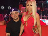 Blac Chyna and Rob Kardashian at a strip club promo event