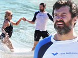 Exclusive... 52022735 'Wolverine' actor Hugh Jackman and his wife Deborra-Lee Furness enjoy a cool dip in the ocean while on vacation in St. Barts, France on April 13, 2016. The happy couple are currently celebrating their 20th wedding anniversary! Jackman, who has been diagnosed with skin cancer several times in the last couple of years, didn't seem to mind catching some rays in the ocean with his wife. Deborra-Lee could be seen sporting a small bandage on her right foot during the swim!\n 'Wolverine' actor Hugh Jackman and his wife Deborra-Lee Furness enjoy a cool dip in the ocean while on vacation in St. Barts, France on April 13, 2016. The happy couple are currently celebrating their 20th wedding anniversary! Jackman, who has been diagnosed with skin cancer several times in the last couple of years, didn't seem to mind catching some rays in the ocean with his wife. Deborra-Lee could be seen sporting a small bandage on her right foot during the swim! FameFlynet, Inc - Beverly Hills