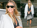 EXCLUSIVE: Elle Macpherson spotted carrying her Hermes Zebra handbag while out in a rainy day in New York City, the model was a grey coat over  her shoulders ....Pictured: Elle Macpherson..Ref: SPL1262406  120416   EXCLUSIVE..Picture by: Felipe Ramales / Splash News....Splash News and Pictures..Los Angeles: 310-821-2666..New York: 212-619-2666..London: 870-934-2666..photodesk@splashnews.com..