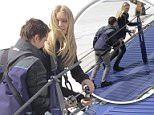 matt bellamy and elle evans climb over the london 02 arena just before his performance there tonight with muse