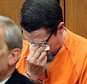 Bobby Hernandez wipes his tears as his son states in court that he does not think his father should go to jail in Judge Cassandra Collier-Williams' courtroom at the Cleveland Justice Center in Cleveland, Ohio on Wednesday, April 13, 2016. Hernandez's attorney is Ralph DiFranco, left. The prosecution of  Hernandez for having taken his then 5-year-old son from the boyís mother in Alabama in 2002 put Julian Hernandez, now a high school senior preparing for college, in an awkward position during the hearing where his father was sentenced to four years for kidnapping him. (Chuck Crow/The Plain Dealer via AP) NO SALES