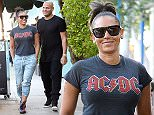 **EXCLUSIVE**  Date: April 11th 2016  Photo Credit: MOVI Inc.\nMel B dresses down in an AC/DC t-shirt some cut off trousers and some colorful sneakers as she heads out for an early dinner with her husband Stephen Belafonte at Dan Tana's Italian restaurant in West Hollywood,CA.