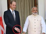 epa05255249 A strong handshake  by Indian prime minister Nanrendra Modi (C) leave a impression at the Britain's Prince William's hand prior to a meeting  at Hyderabad House in New Delhi, India 12 April 2016. Prince William and his wife Catherine are on a visit to India and Bhutan from 10 to 16 April.  EPA/HARISH TYAGI