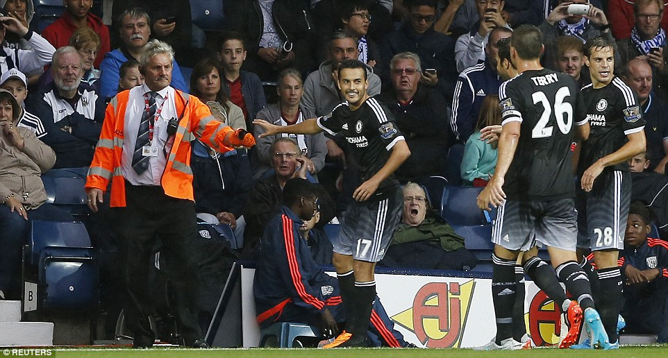 Chelsea's new winger Pedro celebrated by taking his boot off and is pictured having it handed back by a steward at The Hawthorns on Sunday