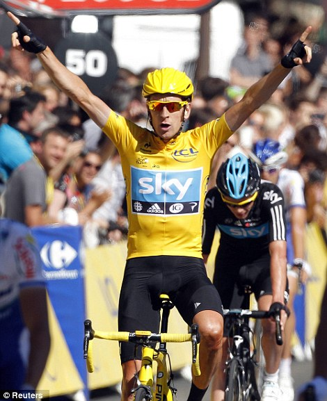 I'm the winner: Bradley Wiggins celebrates in Paris this afternoon after his victory in the Tour De France