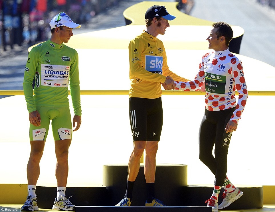 Wiggins shakes hands with Thomas Voeckler of France, who is wearing the red polka dot jersey of the Tour's best climber, as Peter Sagan of Slovakia in the best sprinter's green jersey looks on