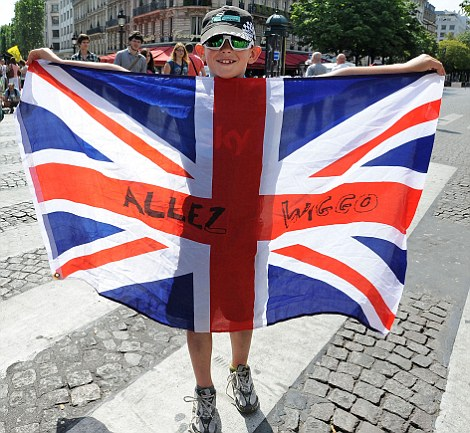 Flying the flag: A young fan in Paris bears the message 'Allez Wiggo'