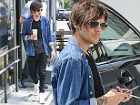 *EXCLUSIVE* Beverly Hills, CA - Louis Tomlinson takes time for a fan during a coffee run in Beverly Hills. The One Direction singer was smoking a cigarette in the parking lot when fans noticed him and asked for a picture, Louis kindly obliged the young lady with several pictures before meeting up with this bodyguard to grab a coffee and going about his day.\nAKM-GSI   April 14, 2016\n \n To License These Photos, Please Contact :\n \n Steve Ginsburg\n (310) 505-8447\n (323) 423-9397\n steve@akmgsi.com\n sales@akmgsi.com\n \n or\n \n Maria Buda\n (917) 242-1505\n mbuda@akmgsi.com\n ginsburgspalyinc@gmail.com