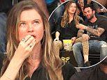 Adam Levine and Behati Prinsloo out at the Lakers game. The Los Angeles Lakers defeated the Utah Jazz by the final score of 101-96 in Lakers Kobe Bryant's last NBA game at Staples Center in downtown Los Angeles, CA.  Pictured: Adam Levine and Behati Prinsloo Ref: SPL1260530  130416   Picture by: London Ent / Splash News  Splash News and Pictures Los Angeles: 310-821-2666 New York: 212-619-2666 London: 870-934-2666 photodesk@splashnews.com
