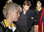 """11 April 2016 - Brentwood, CA - USA\n**STRICTLY AVAILABLE FOR UK AND GERMANY USE ONLY**\n*NO WEB USAGE UNTIL FURTHER NOTICE*\n*PREMIUM EXCLUSIVE - MUST CALL FOR PRICING* \nMiley Cyrus and Liam Hemsworth attend the afterparty for the """"Huntsman"""" Premiere at Baltaire Restaurant. Miley holds onto Liam as they make their way through the crowd. Miley is wearing a preppy collared dress paired with a satin bomber jacket that says """"Champ"""" on the back. \nBYLINE MUST READ : AKM-GSI-XPOSURE\n***UK CLIENTS - PICTURES CONTAINING CHILDREN PLEASE PIXELATE FACE PRIOR TO PUBLICATION ***\n*UK CLIENTS MUST CALL PRIOR TO TV OR ONLINE USAGE PLEASE TELEPHONE 0208 344 2007*\n"""