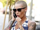 Amber Rose is seen leaving a nail salon with a mystery man in Tarzana, CA.  Pictured: Amber Rose Ref: SPL1262315  140416   Picture by: TC/Splash News  Splash News and Pictures Los Angeles: 310-821-2666 New York: 212-619-2666 London: 870-934-2666 photodesk@splashnews.com