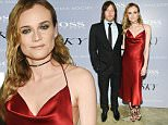 """Actors Norman Reedus and Diane Kruger attend a special screening of """"Sky"""", hosted by The Cinema Society and Hugo Boss, at Metrograph on Thursday, April 14, 2016, in New York. (Photo by Evan Agostini/Invision/AP)"""