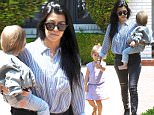 Beverly Hills, CA - Kourtney Kardashian takes the kids to baby class. The mother of three is wearing ripped skinny jeans and a striped button up paired with ankle boots. Penelope looks cute in lavender gingham. Kourtney has her hands full carrying baby Reign to the car. \n  \nAKM-GSI     April 14, 2016\nTo License These Photos, Please Contact :\nSteve Ginsburg\n(310) 505-8447\n(323) 423-9397\nsteve@akmgsi.com\nsales@akmgsi.com\nor\nMaria Buda\n(917) 242-1505\nmbuda@akmgsi.com\nginsburgspalyinc@gmail.com