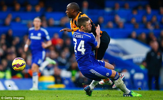 Chelsea defender Gary Cahill goes through Hull's Aluko in this challenge that landed him a booking