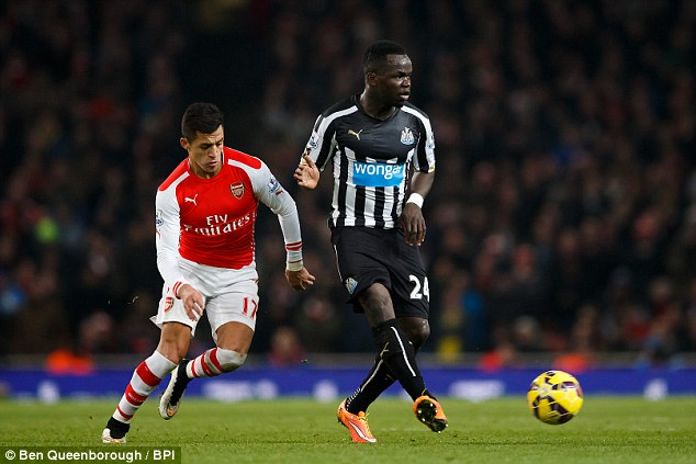 Cheick Tiote (right) should have been sent off for Newcastle United after a challenge on Alexis Sanchez (left)