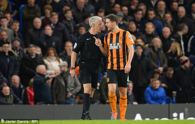 Alex Bruce (right) was booked by Foy for going into a challenge which had too much pace to it