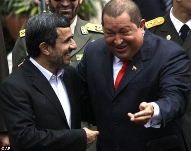 Laughing: Mahmoud Ahmadinejad, left, shares a joke with Hugo Chavez as he arrives in Caracas