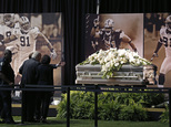 New Orleans Saints owner Tom Benson and his wife Gayle Benson view the casket of former Saints defensive end Will Smith during a public viewing inside the team's NFL football training facility in Metairie, La., Friday, April 15, 2016. Smith was shot to death this past Saturday, and his wife wounded by gunfire, after an altercation following a traffic accident. (AP Photo/Gerald Herbert)