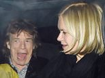 13 April 2016 - London - UK ***PREMIUM EXCLUSIVE - MUST CALL FOR PRICING BEFORE USAGE*** Rolling Stones Frontman Mick Jagger is all smiles as he's pictured Leaving Chuc's restaurant in Mayfair with Mariella Frostrup after enjoying dinner together, The pais can be seen Laughing and Joking as they left in the same Car! BYLINE MUST READ : XPOSUREPHOTOS.COM ***UK CLIENTS - PICTURES CONTAINING CHILDREN PLEASE PIXELATE FACE PRIOR TO PUBLICATION*** **UK CLIENTS MUST CALL PRIOR TO TV OR ONLINE USAGE PLEASE TELEPHONE   44 208 344 2007**
